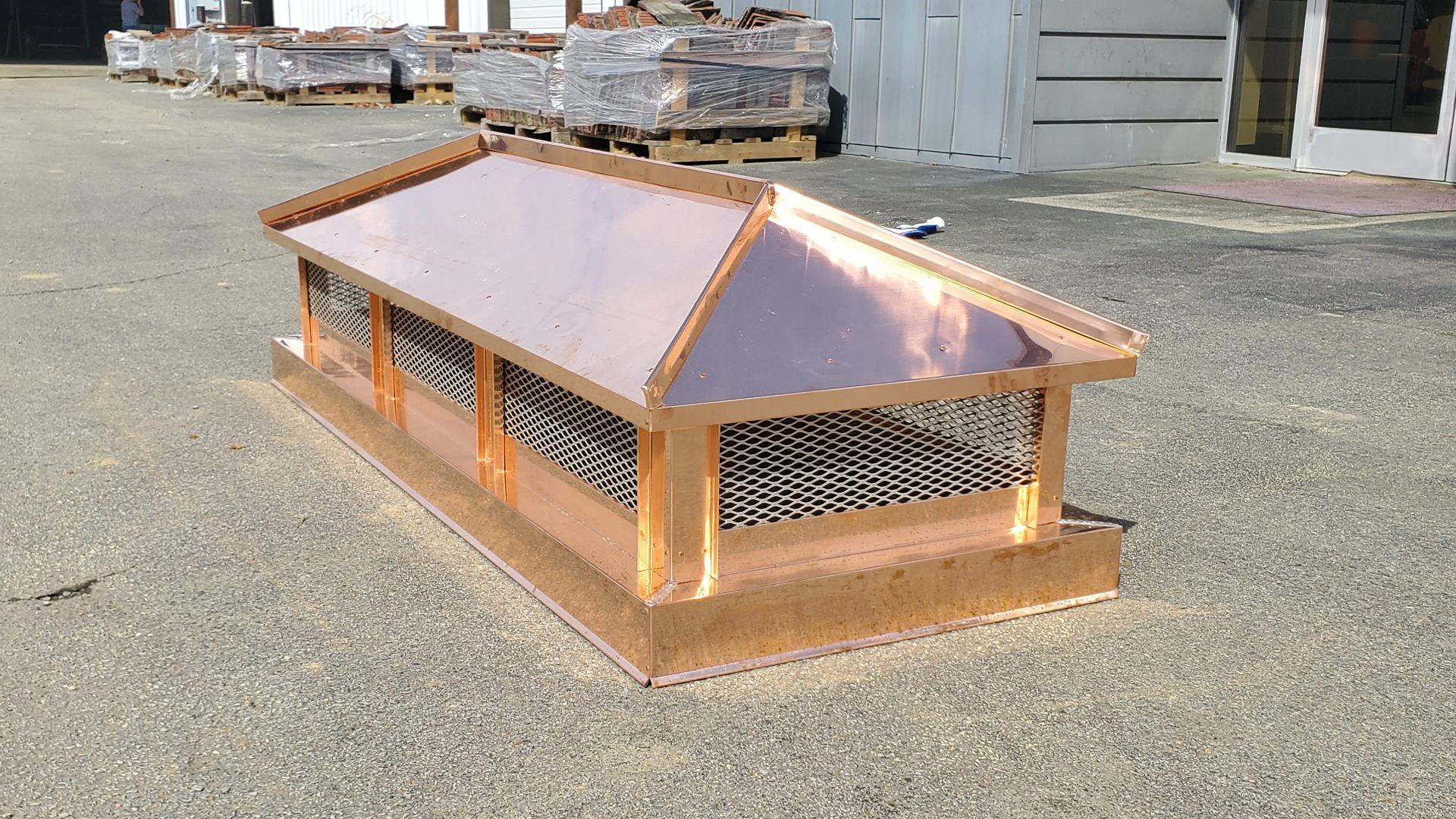 CH103 - Copper hip and ridge roof - custom chimney cap