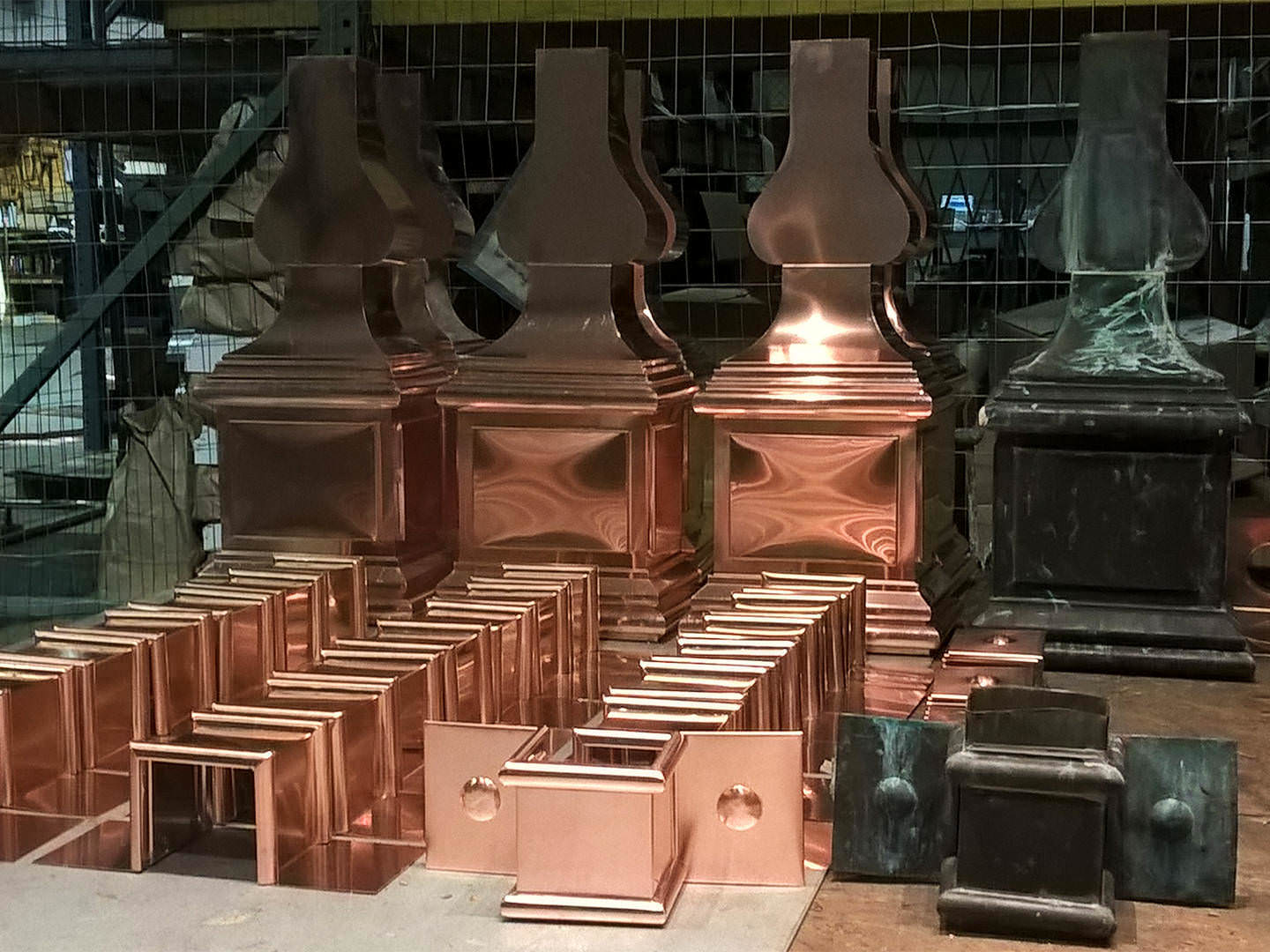 Custom made copper conductor heads with downspout straps