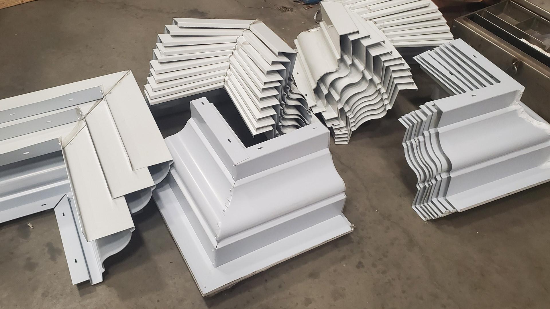 White Kynar aluminum cornice miters