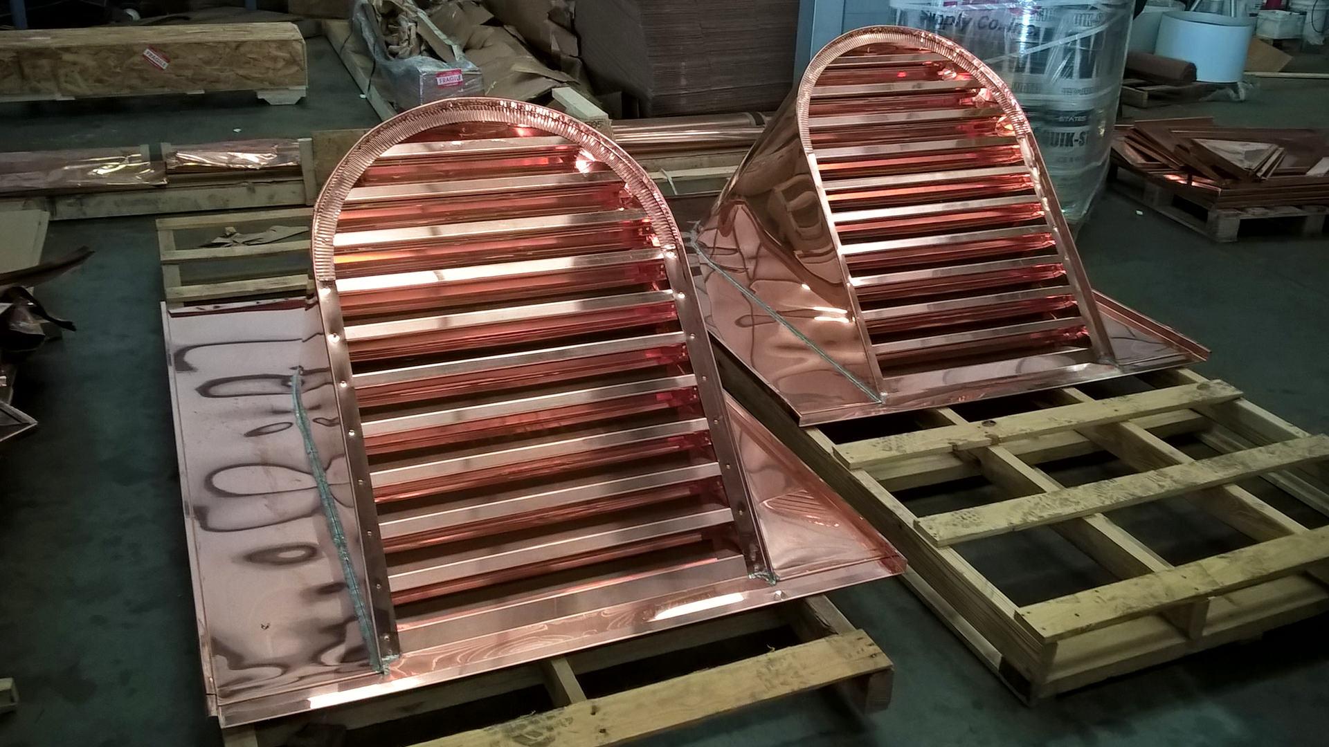 Custom louvered copper barrel dormers