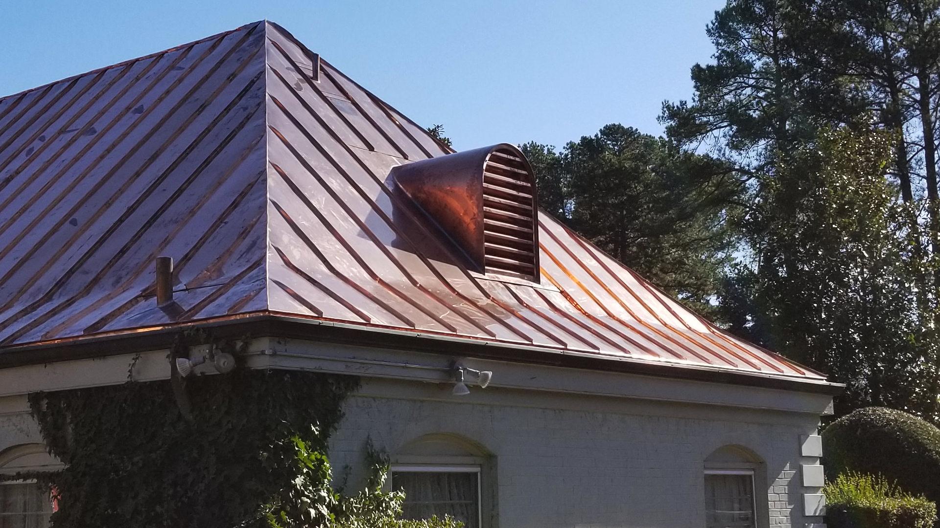 Custom made copper barrel dormer on metal roof