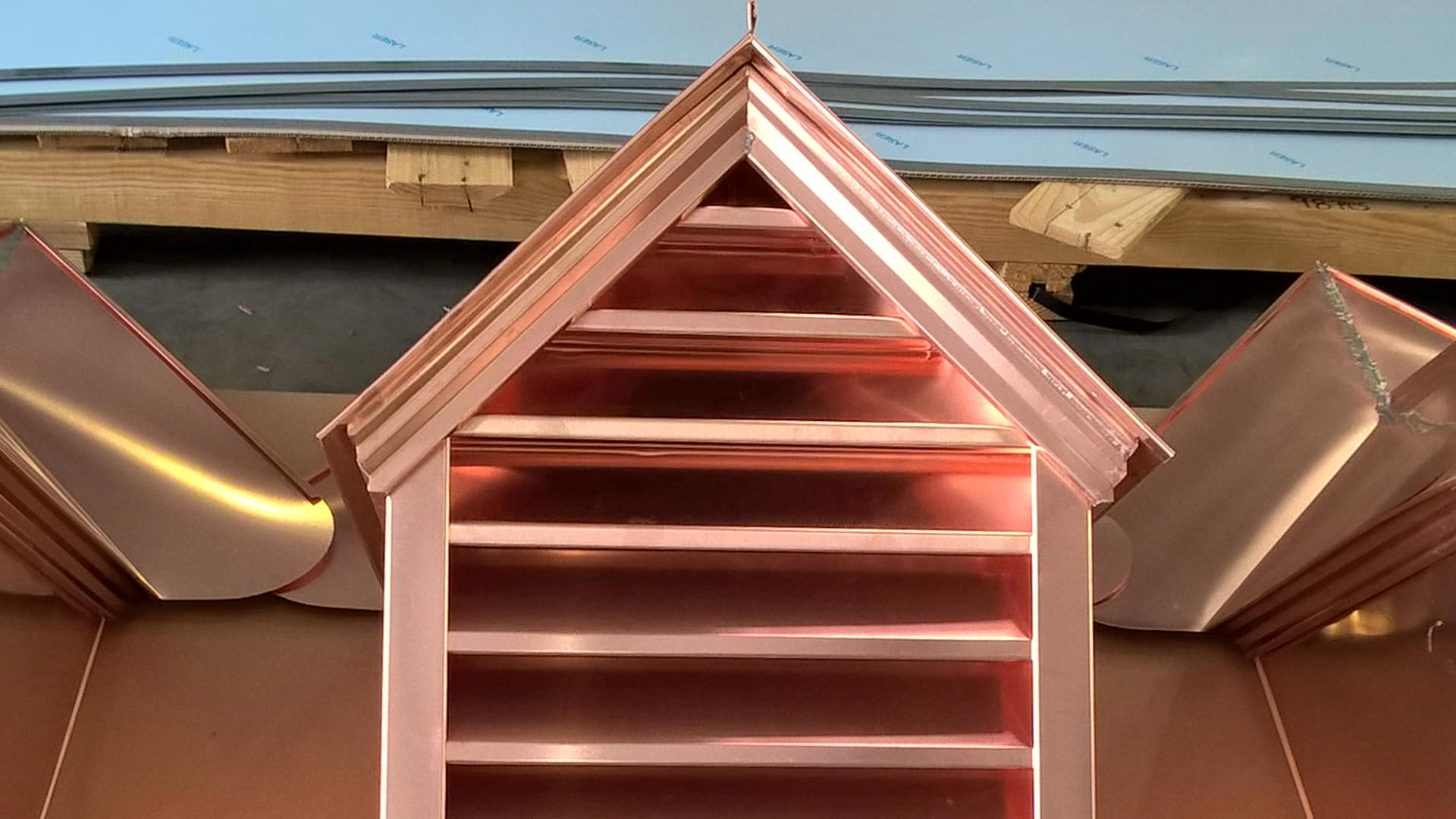 Custom made copper gable dormers