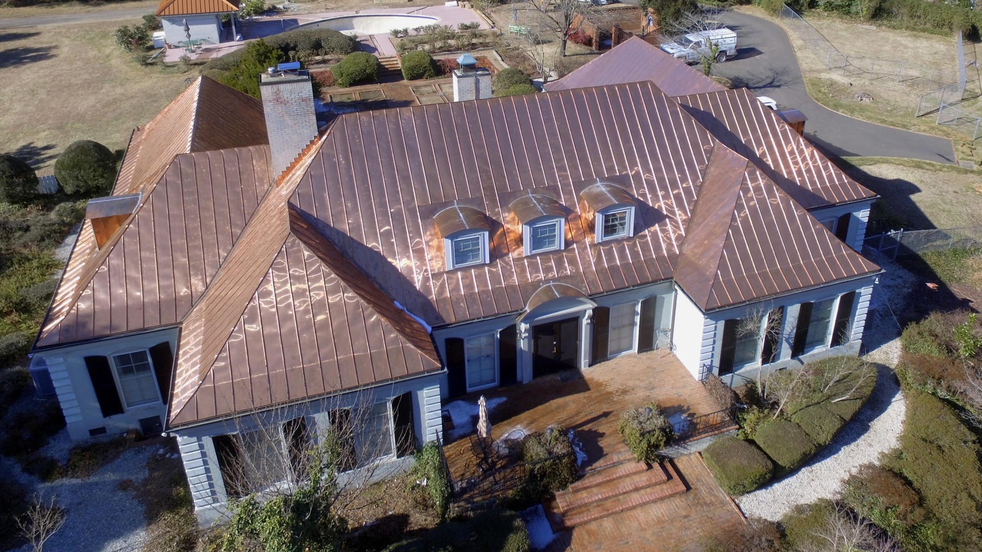 Double lock standing seam copper roof panels and gutters