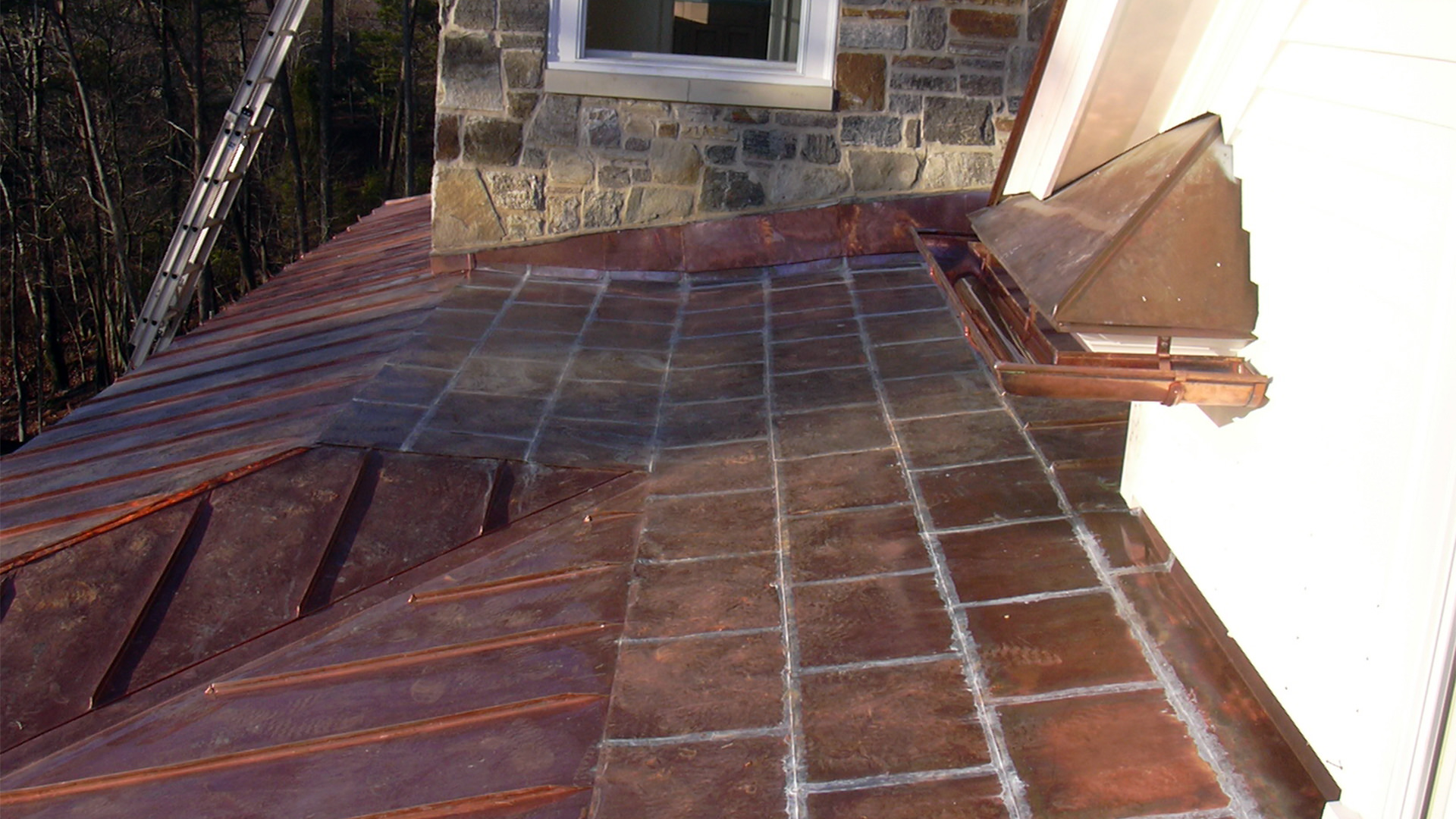 Flat locked and standing seam copper panels